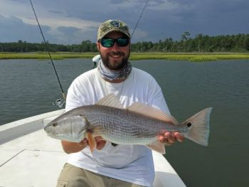 When targeting redfish, guide David Towler moves from creek channels on the low end of the tide to grass-covered marsh islands when the water is up.