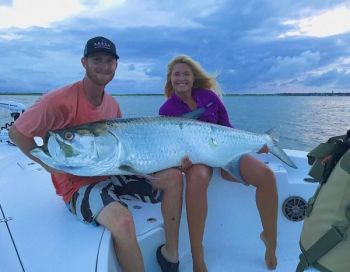 Fishing with David Register, Jamie Renn (right) caught this tarpon, estimated at 100 pounds, in the Cape Fear River.