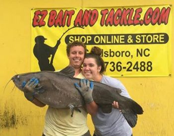 Tyler Barnes and Emily Howell pose with the 68-pound blue catfish they caught on July 30 to win the two-month long EZ Bait and Tackle EZ3 tournament.