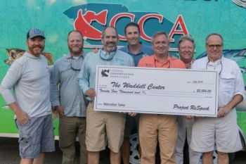Project ReSpeck, a collaboration of RedFin Charters, Z-Man, Eye Strike Fishing, and CCA SC, presented this check to the SCDNR's Waddell Center for fish restoration efforts.