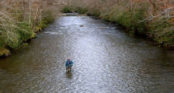 Big streams are ideal for streamer fishing, especially when water is high and dingy, as it often is after summer showers and thunderstorms.