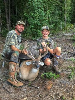 Michael (left) was sitting in the stand with 12-year-old Nate (right) Humphrey when the youth hunter downed this 8-point buck in Orangeburg County, SC on Aug. 11, 2018.