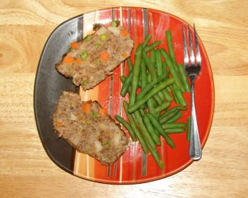 Meatloaf is a hearty meal, especially when it's made with ground venison, and adding some sausage only helps add flavor.