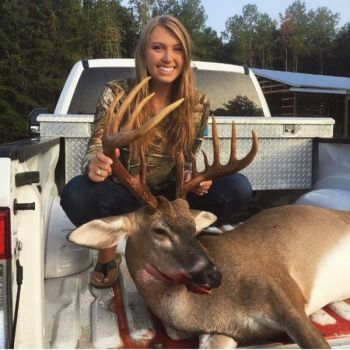 Madison Parker of Florence, SC poses with the 11-point buck she killed on Sept. 6, 2018.