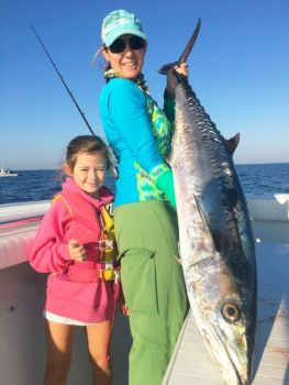 Kara Herring and daughter, Summer, show off a big king mackerel caught off Southport, N.C., last fall.