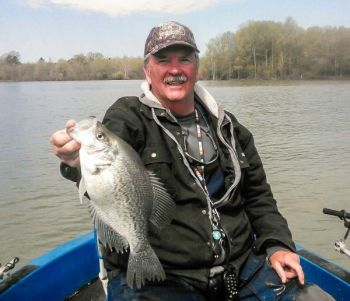 Guide Eddie Moody follows crappie as they move out of deep water this month, normally stopping between 12 and 16 feet deep.