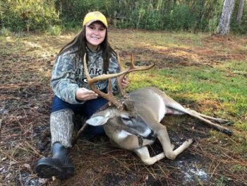 Katelyn Mills of Hampstead, N.C. shows off her Halloween buck she killed on Oct. 31 in Pender County.
