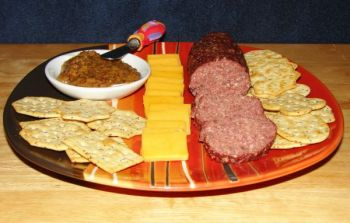 A spicy mustard, cheese and crackers are perfect additions to warm summer sausage.